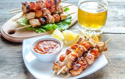 Grilled chicken skewers with cherry tomatoes. Grilled spicy chicken skewers with cherry tomatoes royalty free stock image