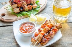 Grilled chicken skewers with cherry tomatoes Stock Image