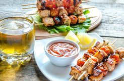 Grilled chicken skewers with cherry tomatoes Stock Photos