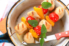 Grilled chicken skewers. Grilled chicken chunks with cherry tomatoes and yellow pepper on skewers Stock Photo