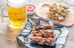 Grilled chicken skewers with herbs and spicy sauce Stock Photography