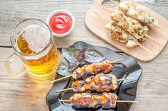 Grilled chicken skewers with herbs and spicy sauce Royalty Free Stock Photos