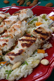Grilled chicken skewers on rice royalty free stock photo
