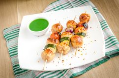 Grilled chicken skewers with zucchini and cherry tomatoes Stock Photo