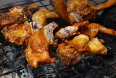 Grilled chicken sold by street food vendor stock photography