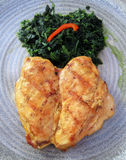 Grilled Chicken and Spinach Royalty Free Stock Images