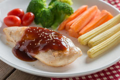 Grilled chicken steak in bbq sauce and vegetable. Stock Images