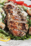 Grilled chicken steak with caesar salad Stock Images