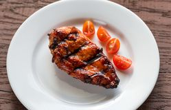 Grilled chicken steak with cherry tomatoes Stock Photography
