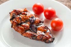 Grilled chicken steak with cherry tomatoes Stock Photos