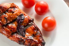 Grilled chicken steak with cherry tomatoes Stock Image