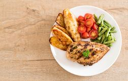 Grilled chicken steak. With potatoes tomatoes and green beans Stock Image