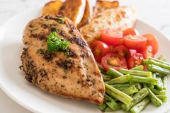Grilled chicken steak. With potatoes tomatoes and green beans Royalty Free Stock Photography