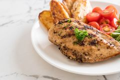Grilled chicken steak. With potatoes tomatoes and green beans Royalty Free Stock Images