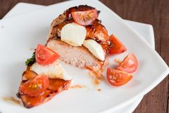 Grilled chicken steak with mozzarella and cherry tomatoes Stock Images