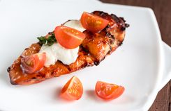 Grilled chicken steak with mozzarella and cherry tomatoes Royalty Free Stock Photography