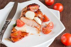 Grilled chicken steak with mozzarella and cherry tomatoes Royalty Free Stock Photo