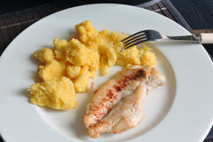 Grilled chicken steak with polenta. Delicious grilled chicken steak with polenta, simple meal Royalty Free Stock Images