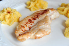 Grilled chicken steak with polenta. Delicious grilled chicken steak with polenta, simple meal Royalty Free Stock Photo