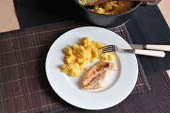 Grilled chicken steak with polenta. Delicious grilled chicken steak with polenta, simple meal Royalty Free Stock Image