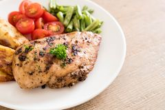 Grilled chicken steak. With potatoes tomatoes and green beans Stock Images