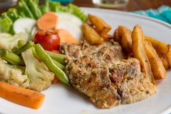 Grilled chicken steak with potatoes and vegetables. Royalty Free Stock Images