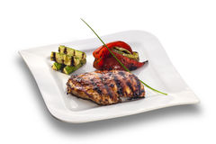 Grilled chicken steak and roasted vegetables Royalty Free Stock Images