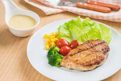 Grilled chicken steak and vegetables on plate Royalty Free Stock Photography