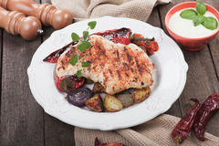 Grilled chicken steak with vegetables Stock Images