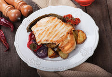 Grilled chicken steak with vegetables Stock Photos