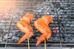 Grilled chicken on a steel grill on fireplace , barbecue , appetizer.  royalty free stock photo
