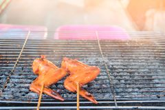 Grilled chicken on a steel grill on fireplace , barbecue , appetizer.  royalty free stock photos