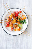 Grilled chicken on sticks with tikka masala sauce Royalty Free Stock Photos