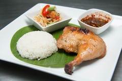Grilled Chicken with Sticky rice. Som tum Thai with sticky rice and grilled chicken Stock Photos