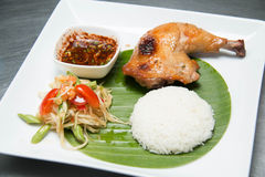 Grilled Chicken with Sticky rice. Som tum Thai with sticky rice and grilled chicken Royalty Free Stock Images