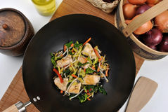 Grilled chicken with stir fry. In a wok Royalty Free Stock Images