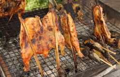 Grilled chicken on stove. Grilled chicken with bamboo stick on stove Stock Photos