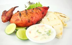 Grilled chicken Tandoori. Accompanied with Vegetable Raita , Pitta BRead and Lime Stock Photography
