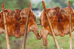 Grilled chicken. Thigh on the flaming grill Royalty Free Stock Photo