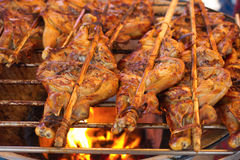 Grilled chicken thigh with herb on the flaming grill ( select fo Royalty Free Stock Photo