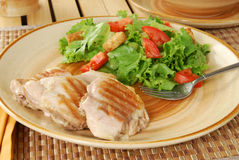 Grilled chicken thighs. And a salad Stock Images