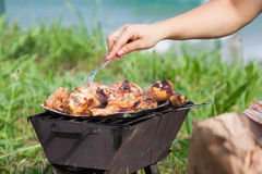 Grilled chicken thighs on the flaming grill. Stock Images