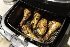 Grilled chicken thighs in non fat fryer stock image