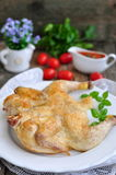 Grilled chicken with a tomato sauce on a wooden table Royalty Free Stock Photo