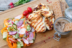Grilled chicken with vegetable salad. Grilled chicken, vegetable salad and pate Royalty Free Stock Photos