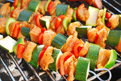 Grilled chicken and vegetable shashliks Stock Photos