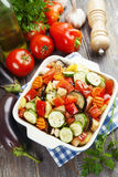 Grilled chicken with vegetables. On the table stock images