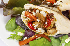 Grilled chicken in warm pitta bread Royalty Free Stock Photography