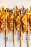 Grilled chicken was spread out with bamboo stick. Stock Photos