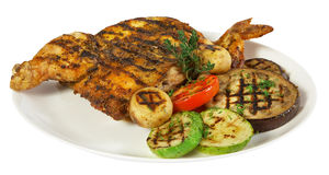 Grilled chicken on white plate. Isolated on white stock photos